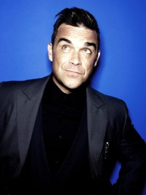 Robbie Williams announces 'Swing Both Ways Live' 2014 headline UK tour